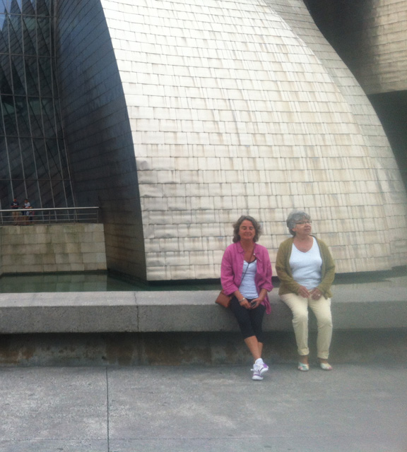 Elizabeth (right) in her arty Cydwoq Link shoes sits outside the Guggeheim in Bilbao, Spain.